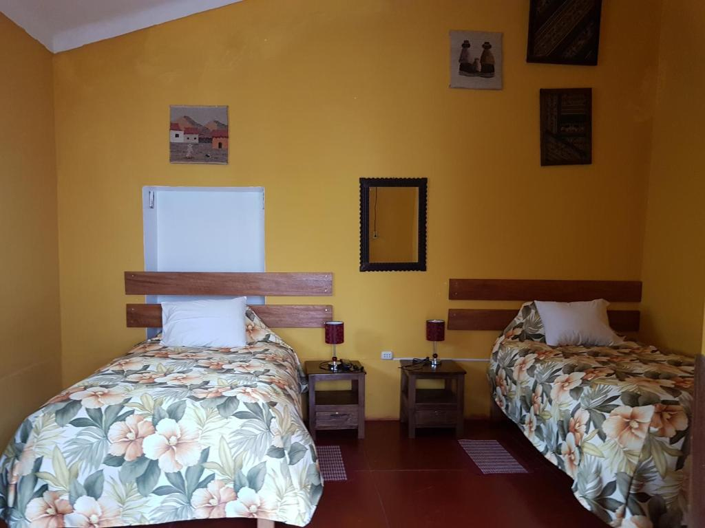 A bed or beds in a room at Hospedaje Familiar Kitamayu Pisac