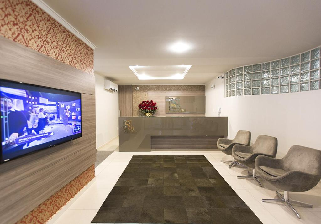 A television and/or entertainment center at Spazio Hotel