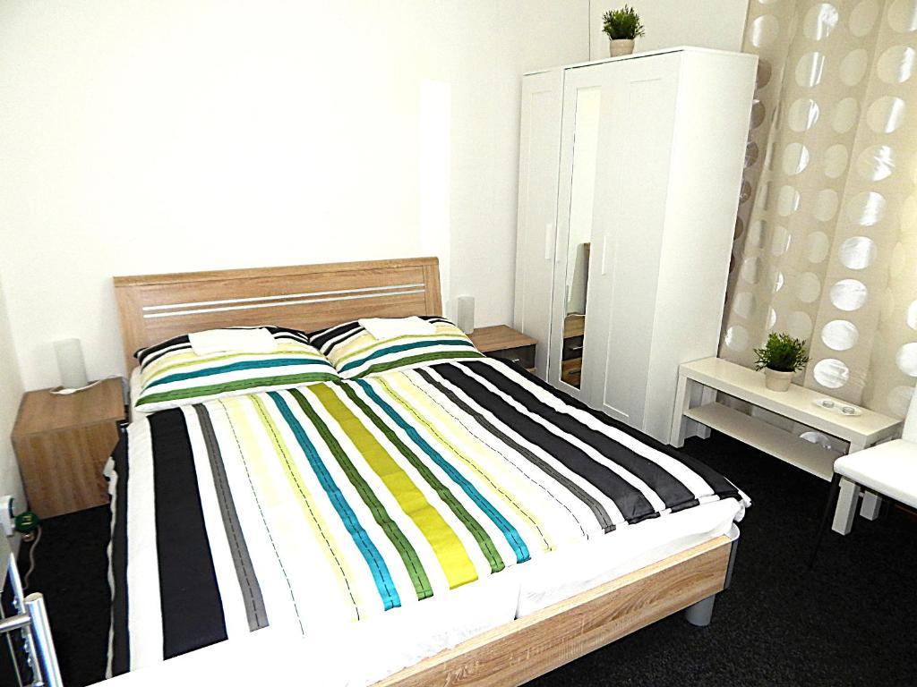 Postel nebo postele na pokoji v ubytování Apartments Ostrava Vítkovice