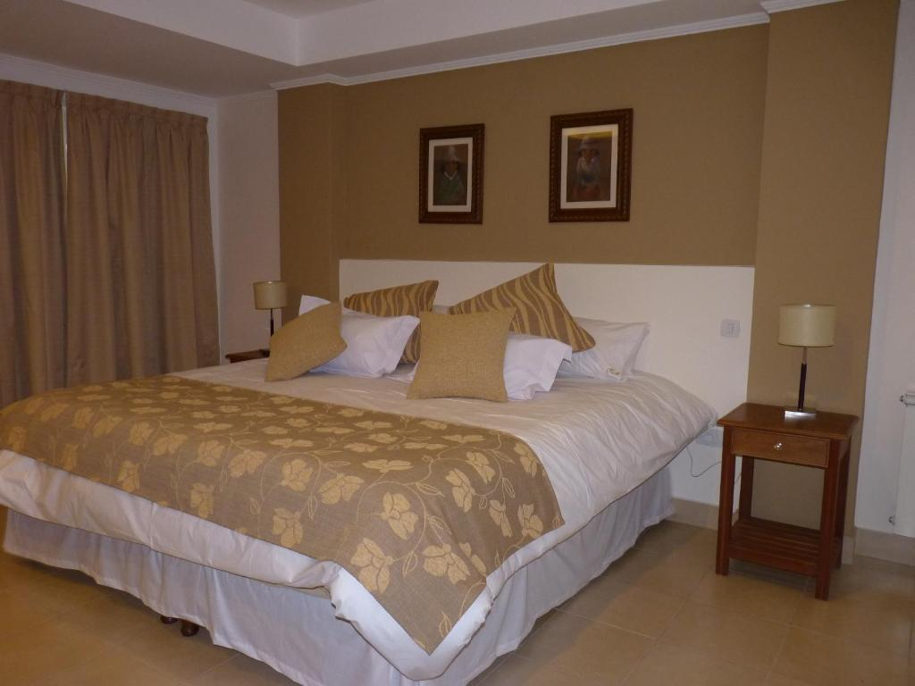 A bed or beds in a room at Hotel Astur
