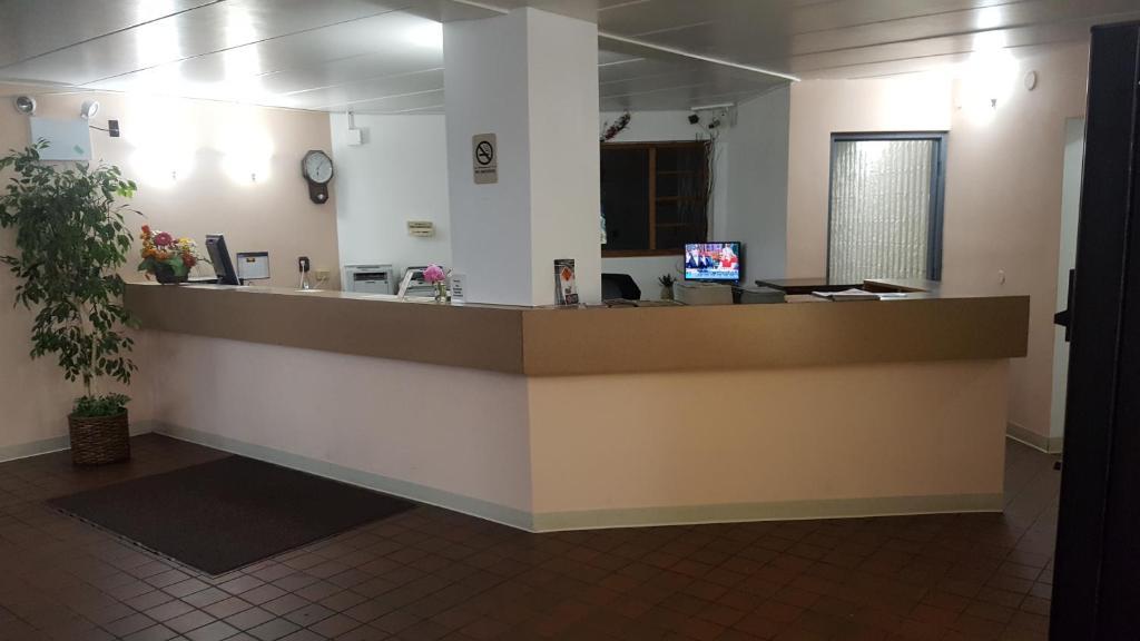 The lobby or reception area at Osseo Inn