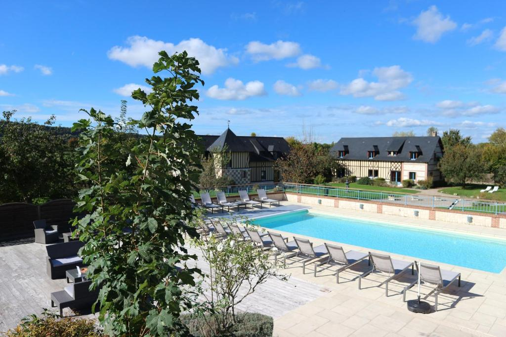 The swimming pool at or near Le Clos Des Fontaines