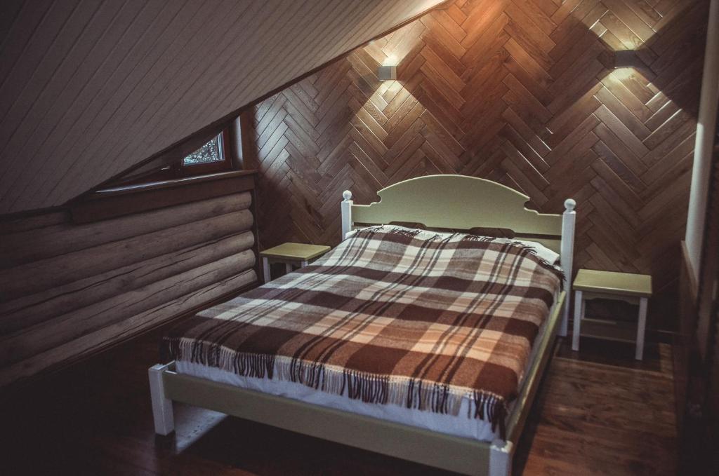 Кровать или кровати в номере Актив-Отель Горки