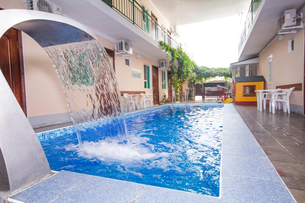 The swimming pool at or near Guest House Vodoley