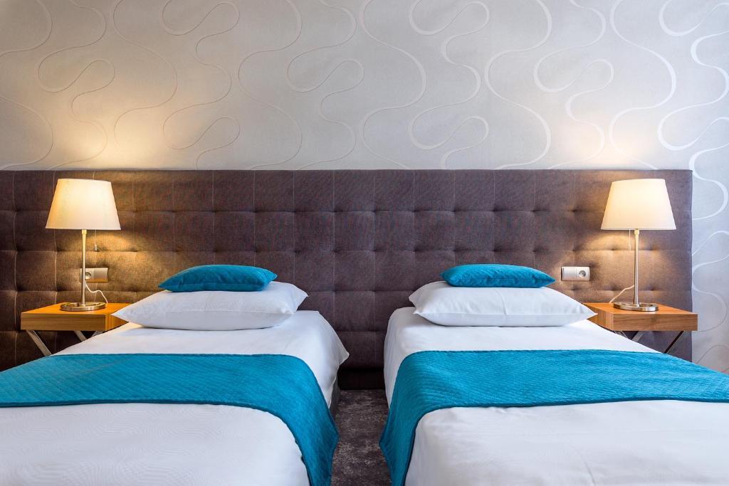 Łóżko lub łóżka w pokoju w obiekcie Hotel Patio