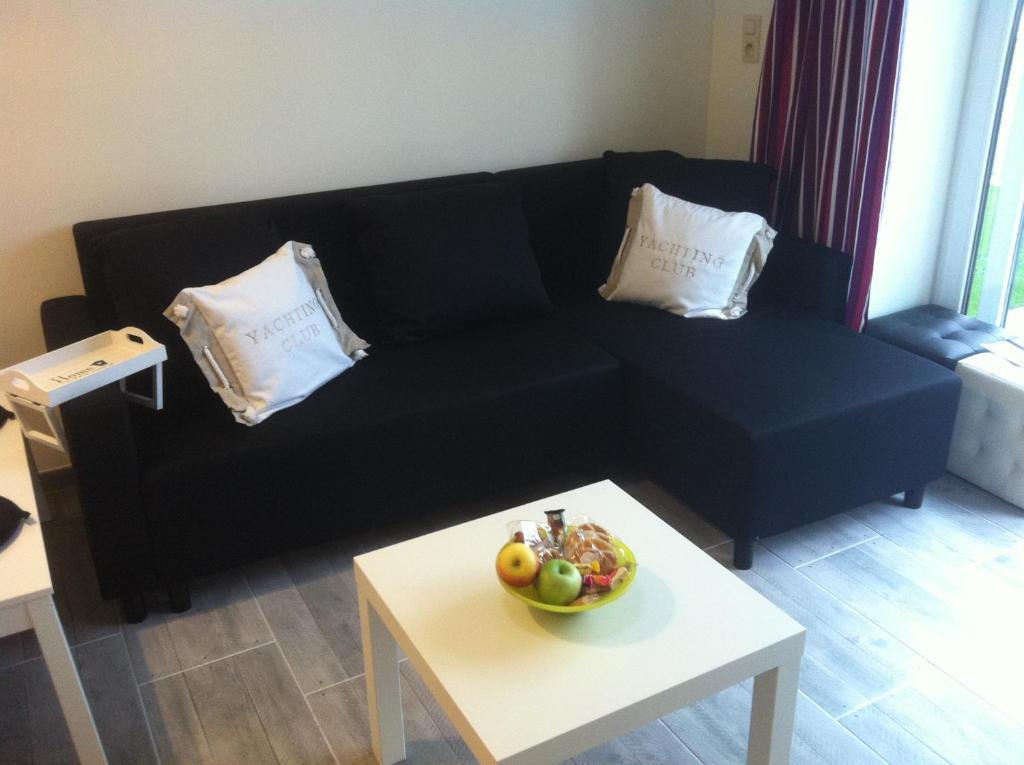 A seating area at Vakantiestudio Melroce
