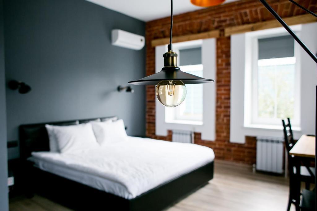 Кровать или кровати в номере Исторический особняк 1825