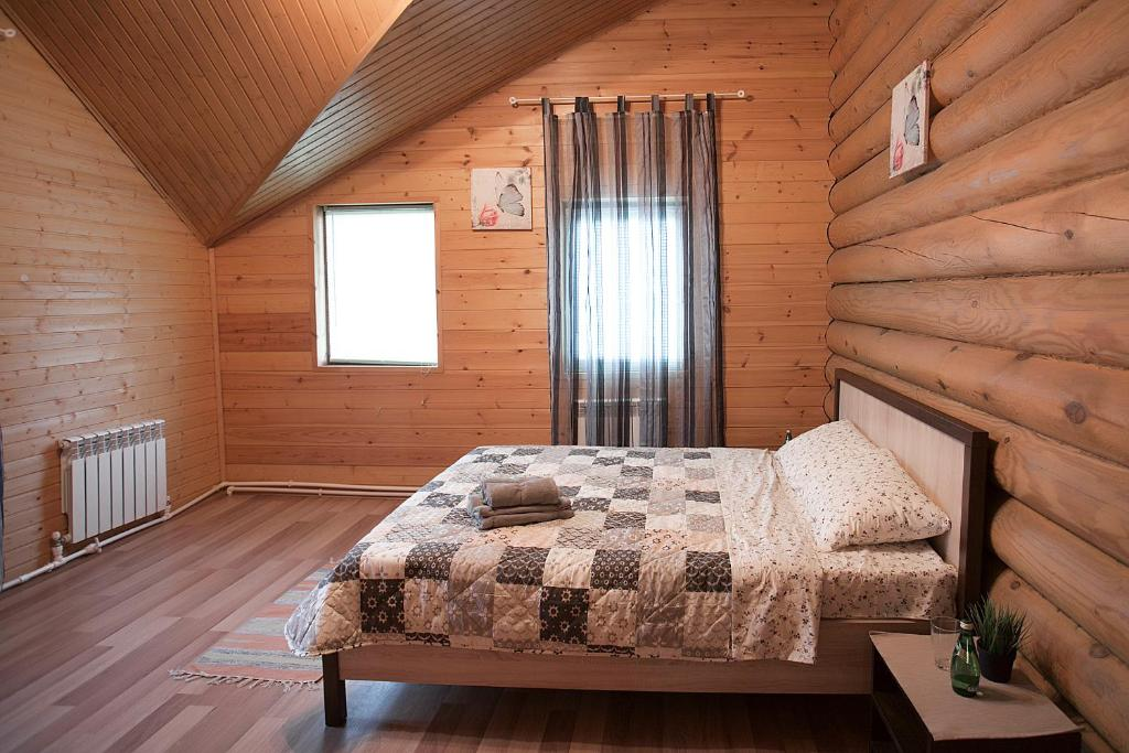 Кровать или кровати в номере Савино Хаус