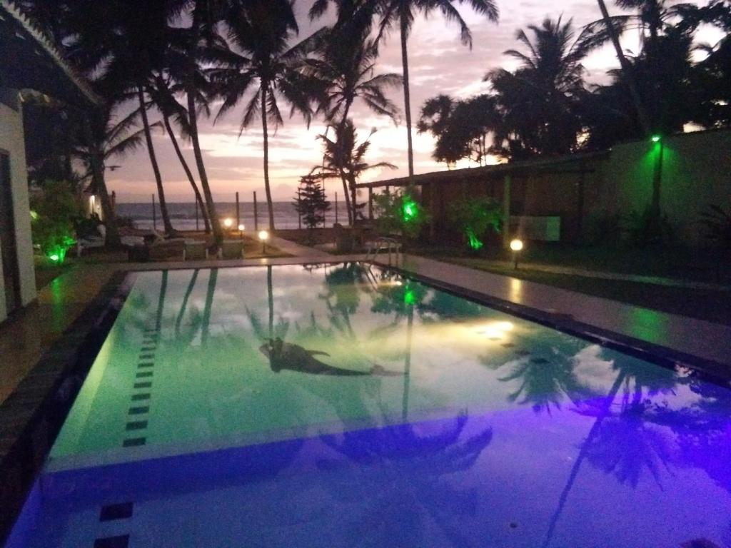 The swimming pool at or near Hotel Ocean View Cottage