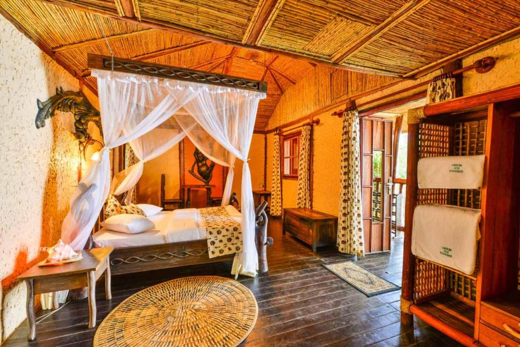 A bed or beds in a room at Serenada Eco Resort