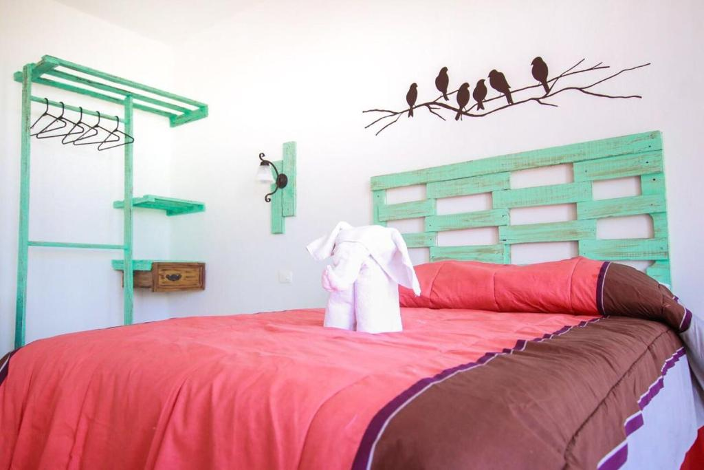A bed or beds in a room at Villas Isza