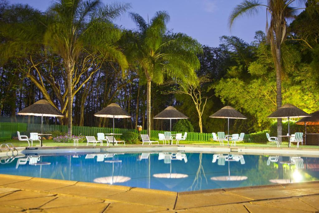 The swimming pool at or near Sunbird Capital
