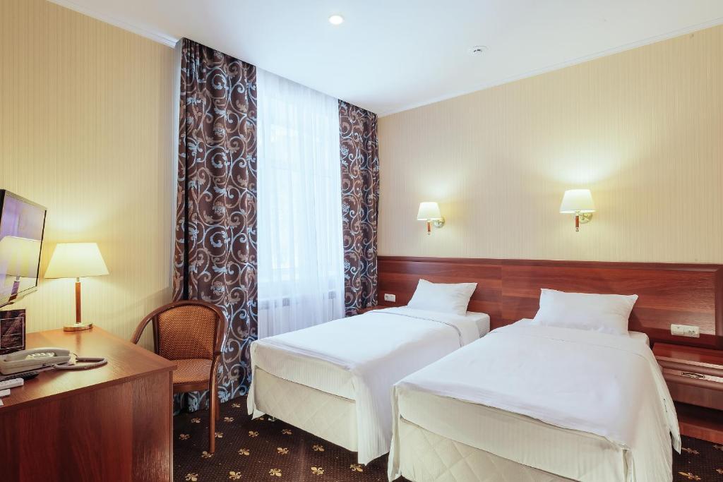 Кровать или кровати в номере Гостиница Амарис