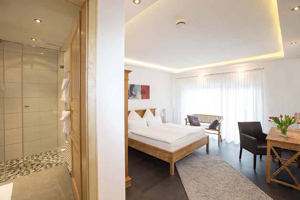 Кровать или кровати в номере Hotel Restaurant Daute