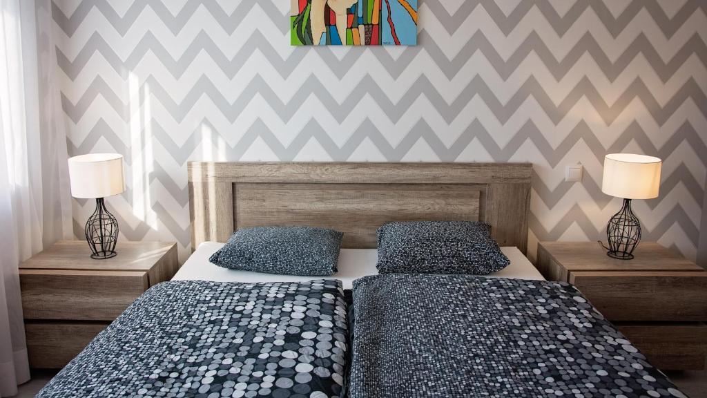 Łóżko lub łóżka w pokoju w obiekcie Apartament Piano 2