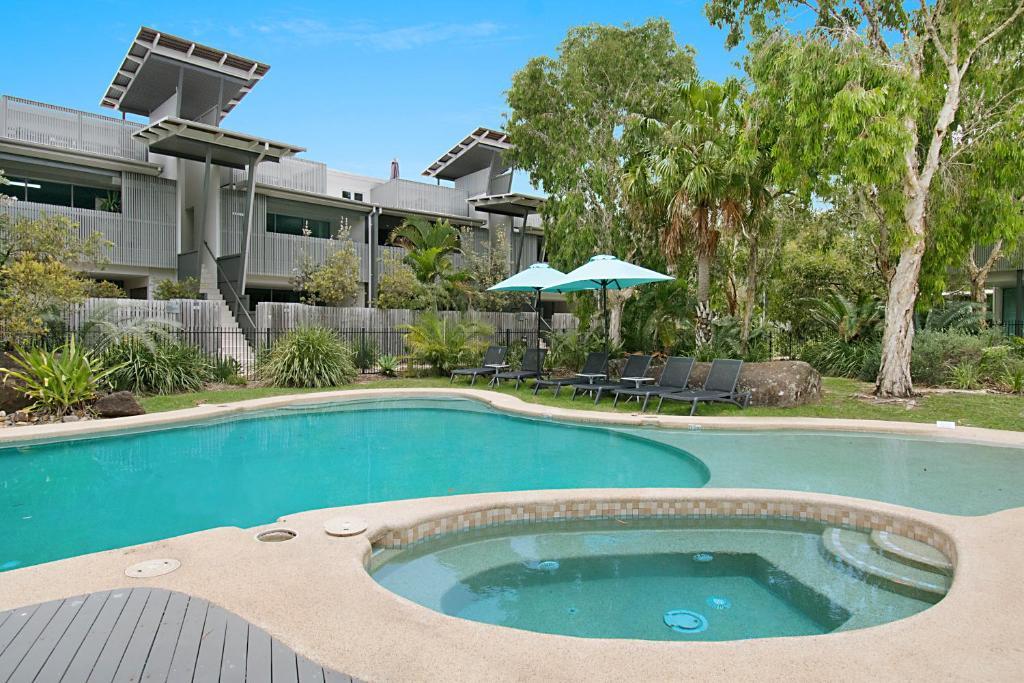 The swimming pool at or near Aquawaters@Belongil