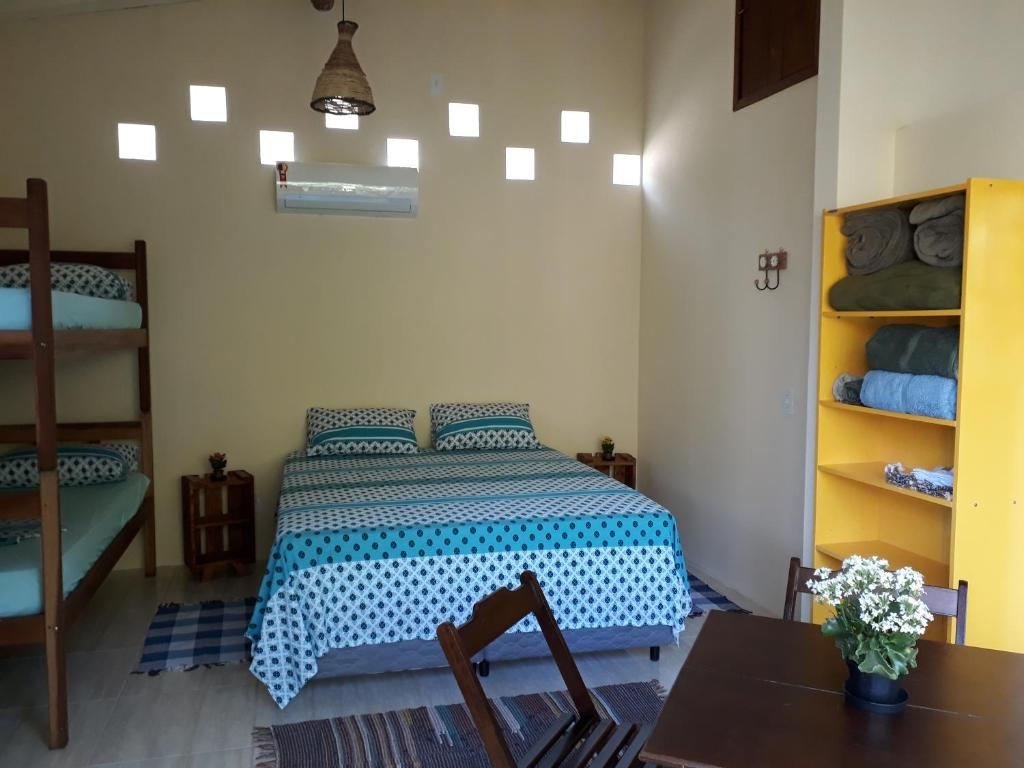 A bed or beds in a room at Chalés Paraty Marias