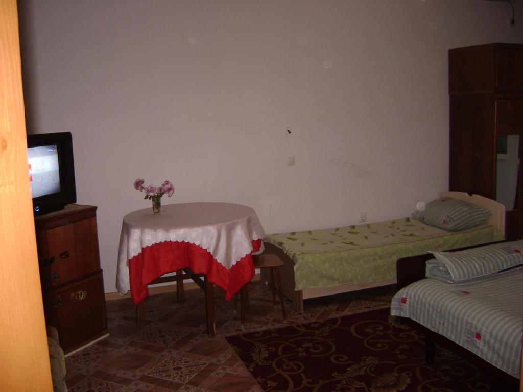 Кровать или кровати в номере Apartment in Elista