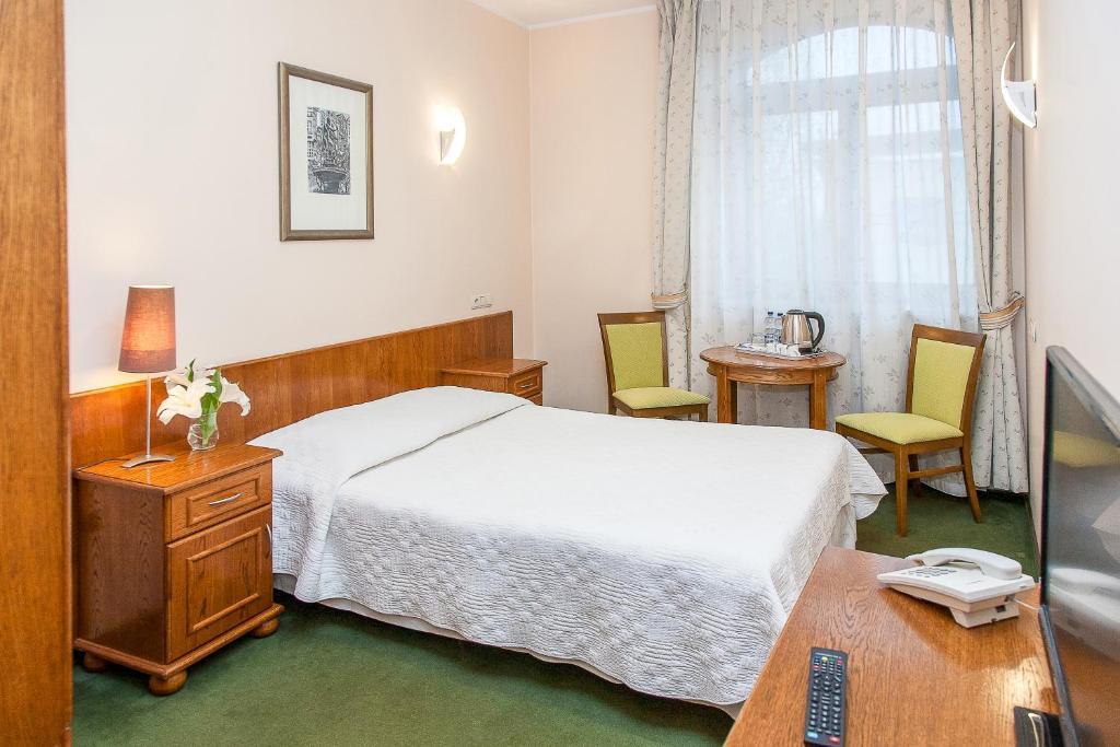 Łóżko lub łóżka w pokoju w obiekcie Willa Biala Lilia Old Town