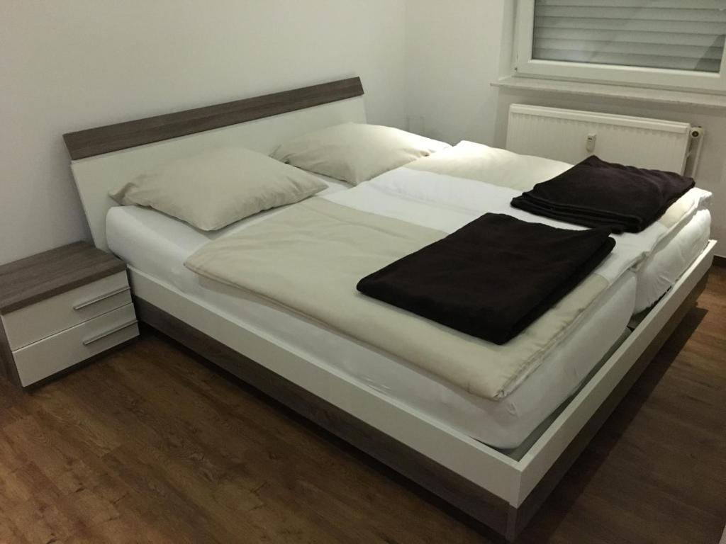 Ein Bett oder Betten in einem Zimmer der Unterkunft Hotel Friesenhof