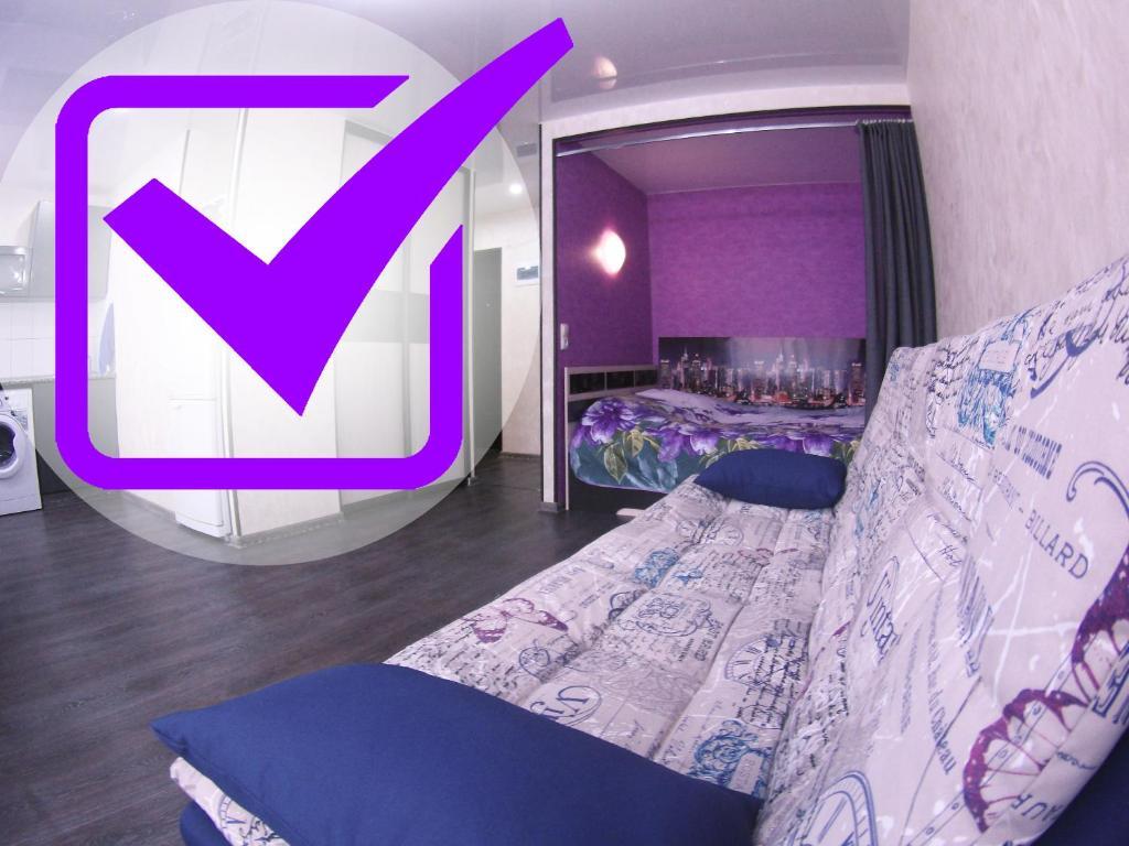 Кровать или кровати в номере Apartment on Lenina 44