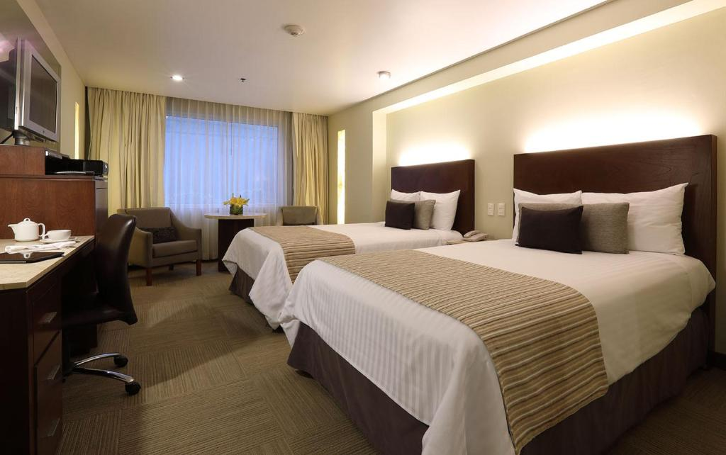 A bed or beds in a room at Emporio Reforma