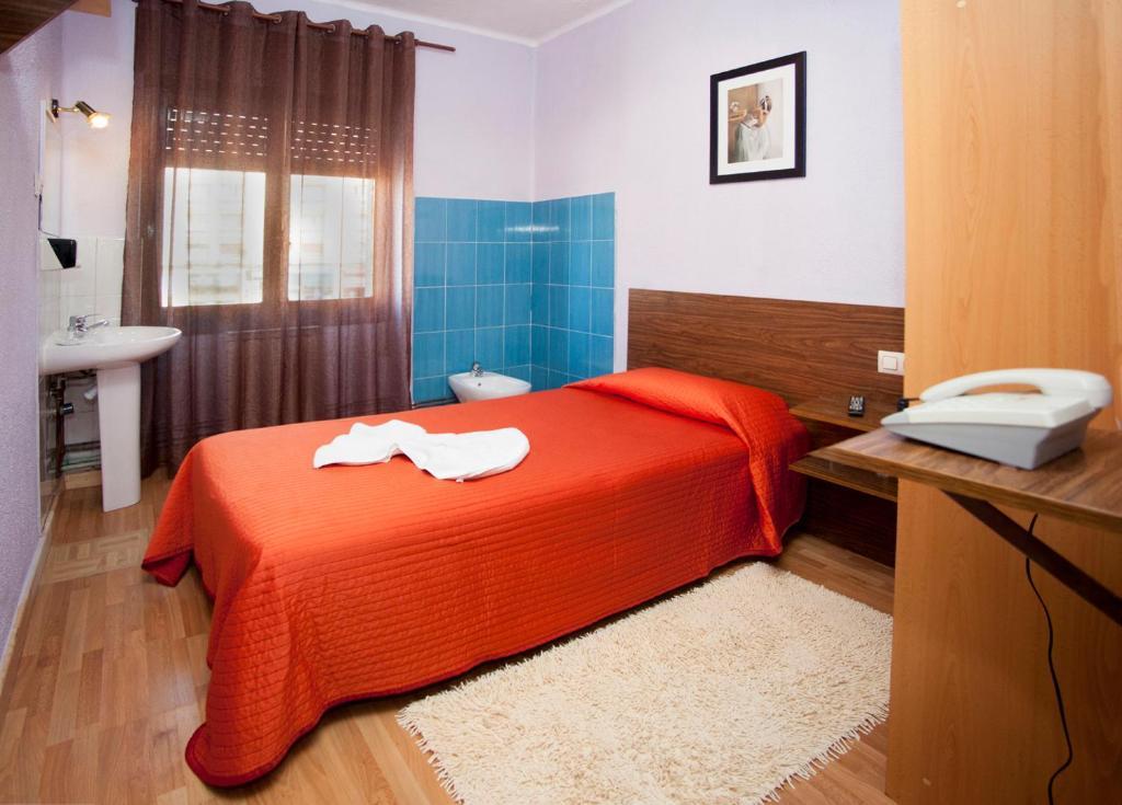 Cama o camas de una habitación en Hostal Goias