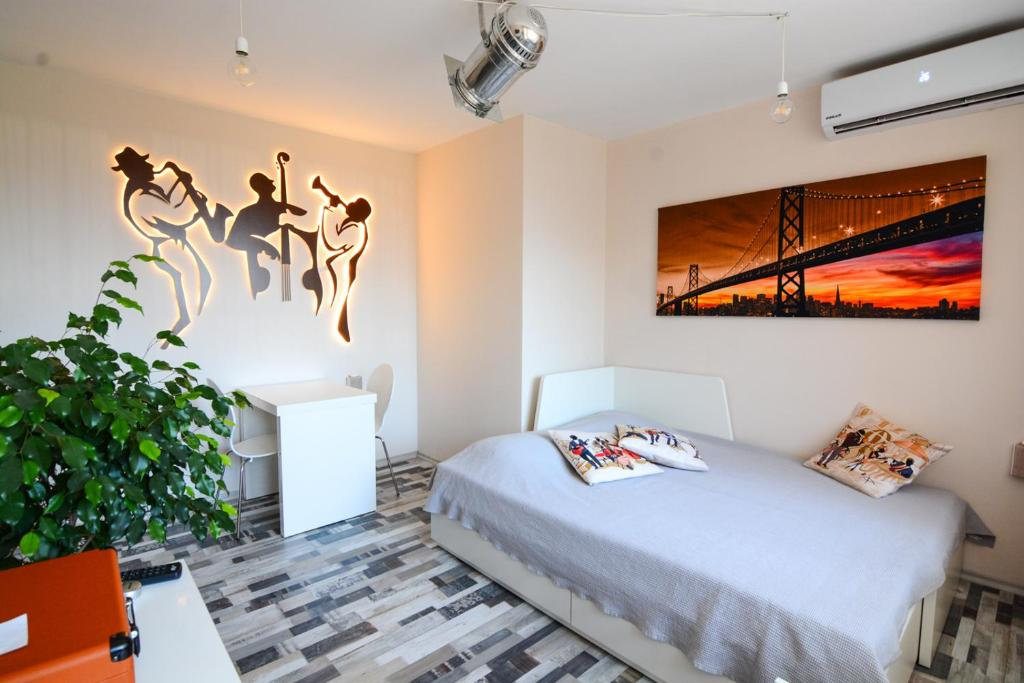 A bed or beds in a room at Jazzy Sofia Downtown Apartment