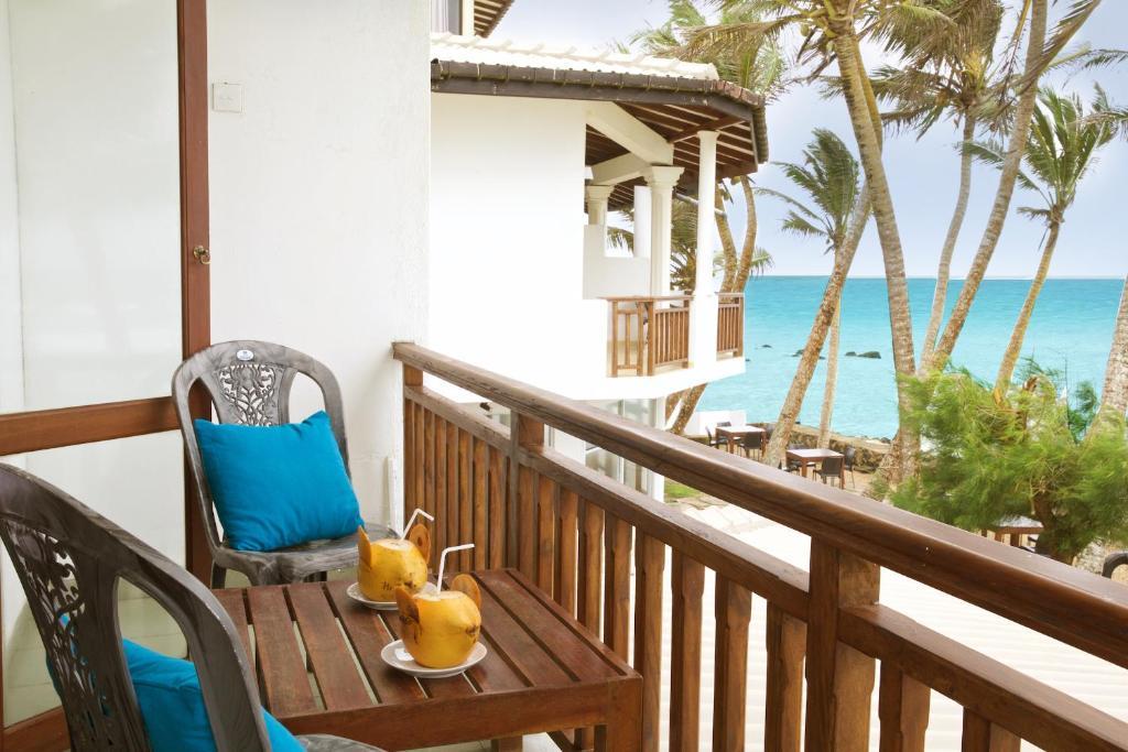 Balcon ou terrasse dans l'établissement Beach Inns Holiday Resort