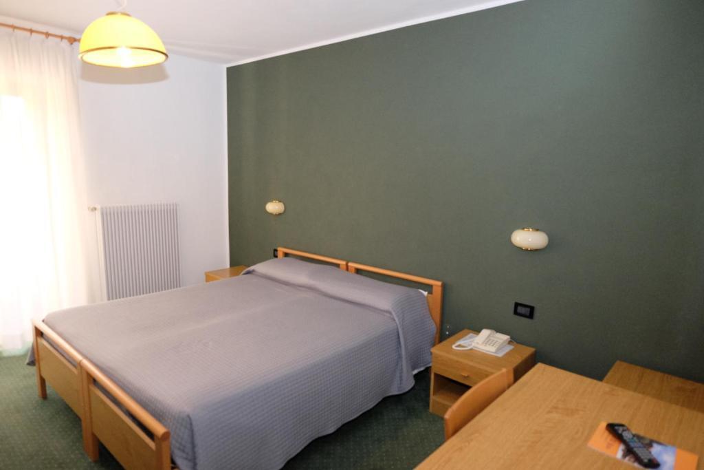 Letto o letti in una camera di Al Pian Hotel