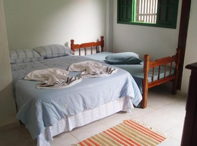 A bed or beds in a room at Hospedagem dos Arvoredos