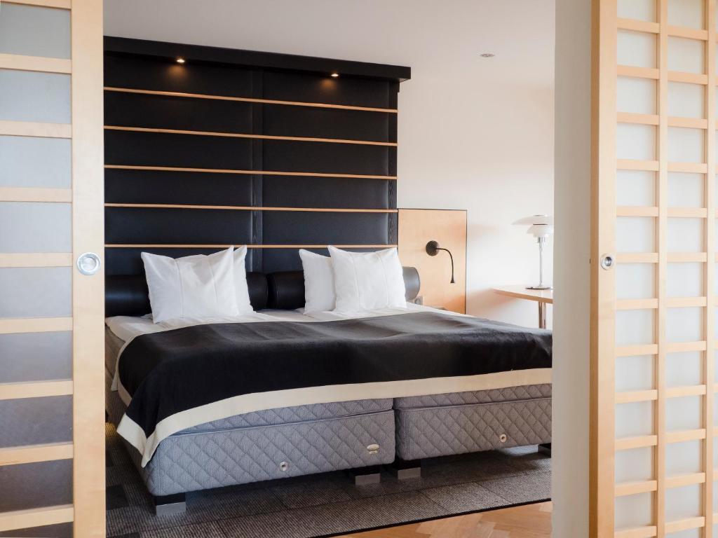 Säng eller sängar i ett rum på Hotel Lundia