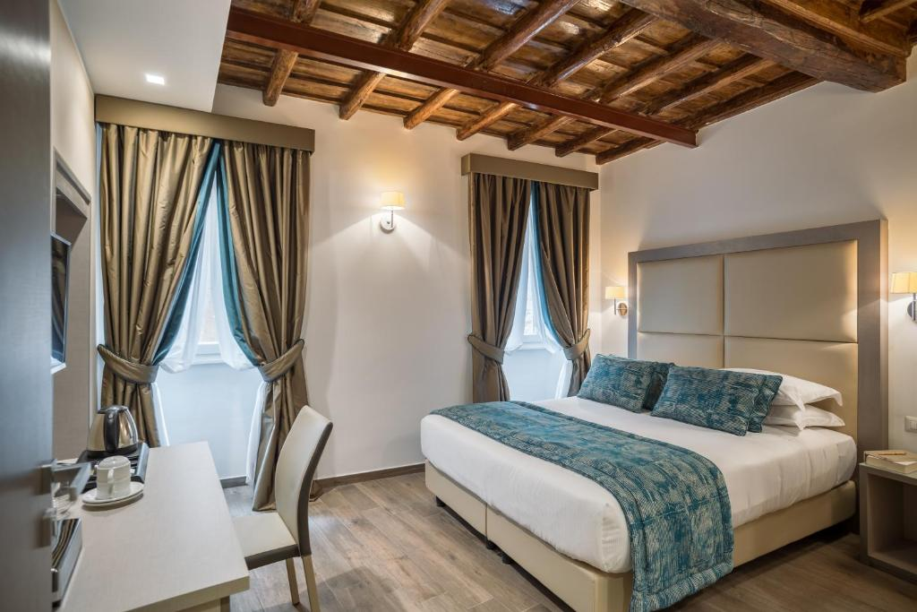 A bed or beds in a room at Reginella Suites