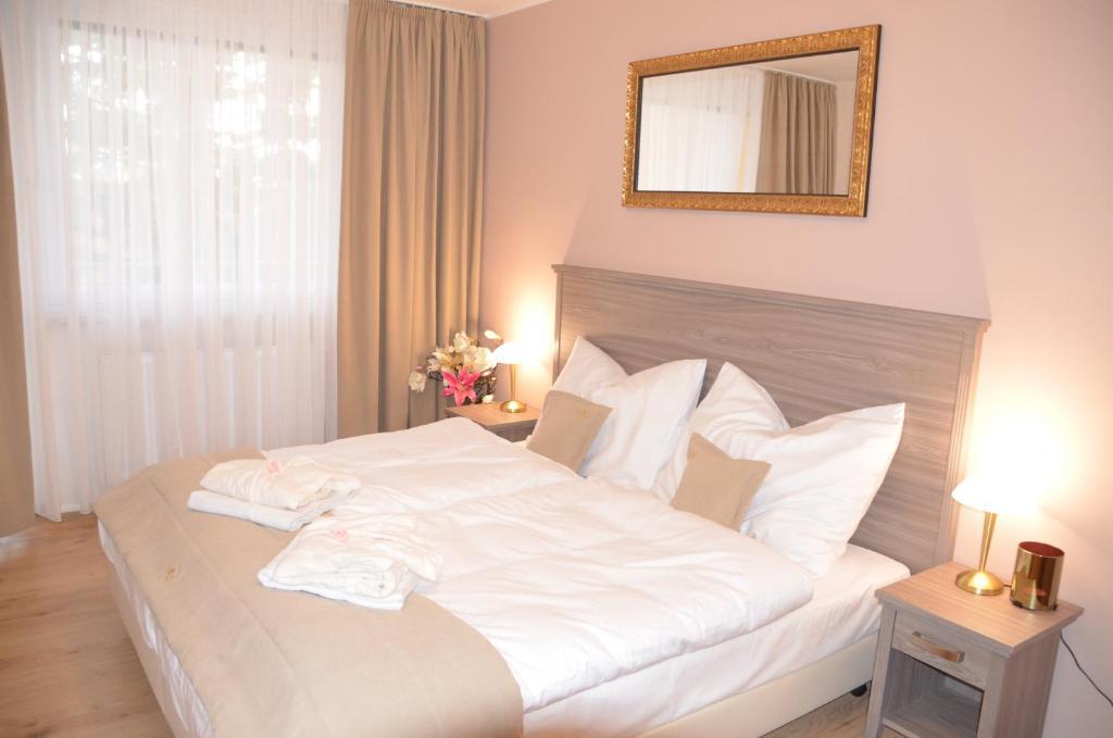 Postel nebo postele na pokoji v ubytování Resort Erich
