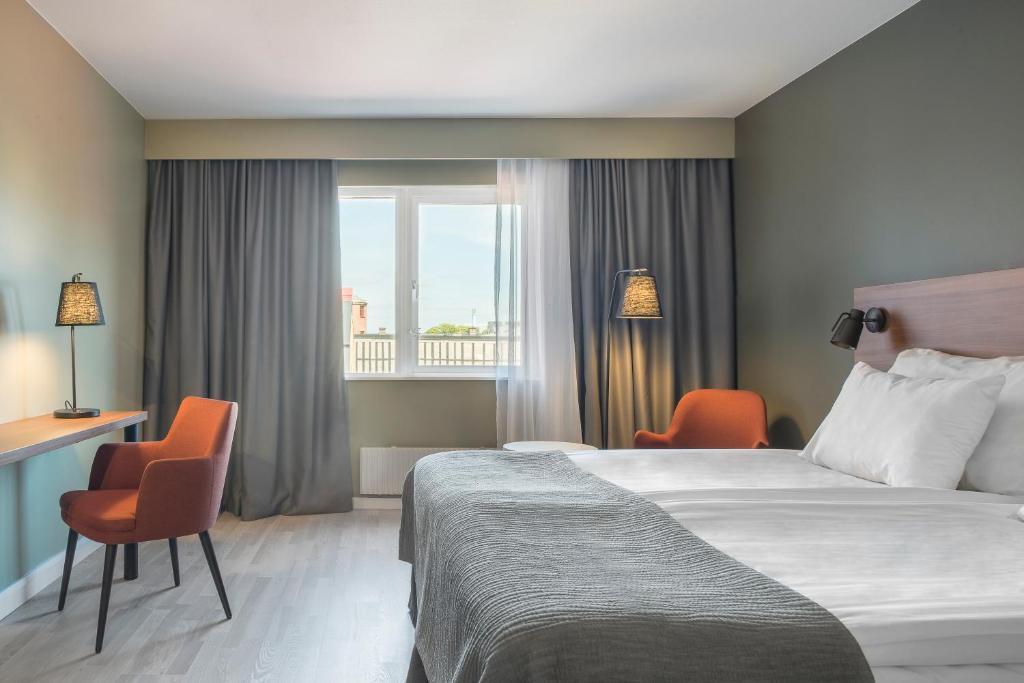 Säng eller sängar i ett rum på Quality Hotel Grand Kristianstad