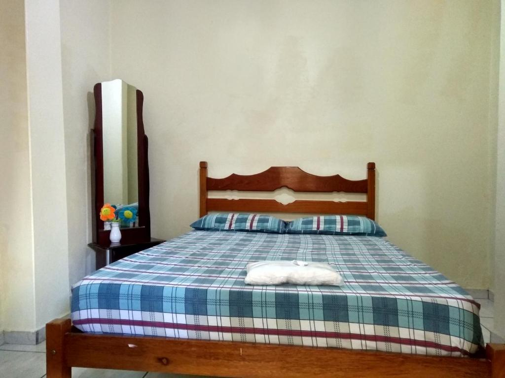 A bed or beds in a room at Hotel Tangará
