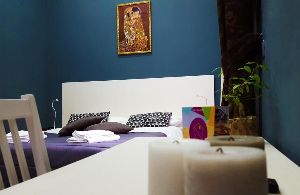 Ένα ή περισσότερα κρεβάτια σε δωμάτιο στο Holiday Naples Art Rooms