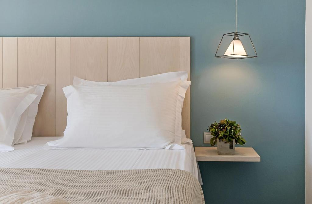 A bed or beds in a room at Lidea Boutique Hotel