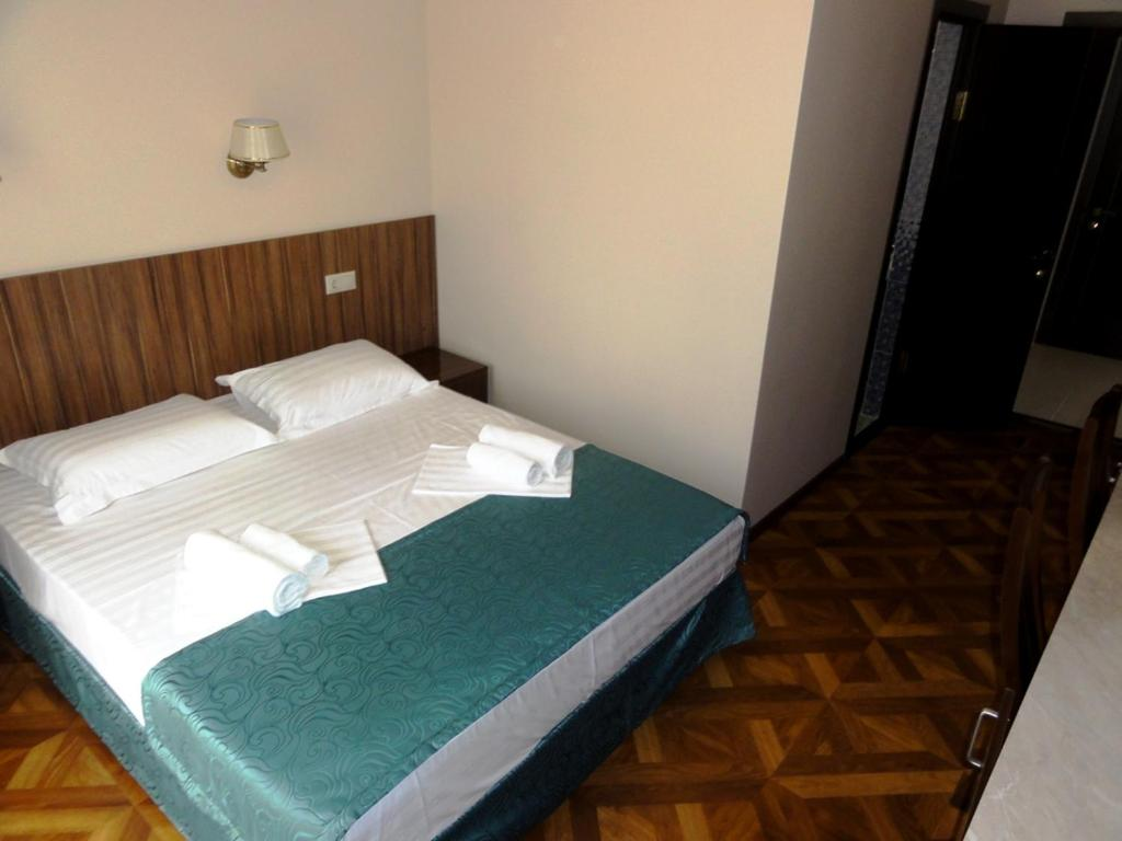 A bed or beds in a room at Guest House Ritsa