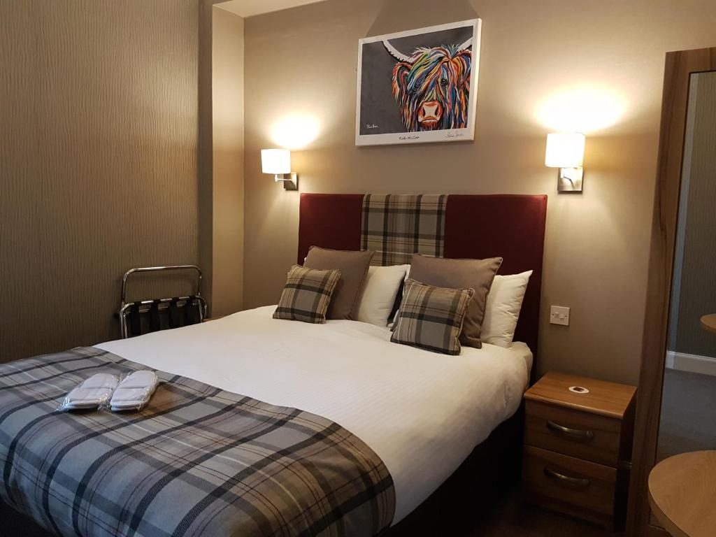 A bed or beds in a room at Fairburn Hotel