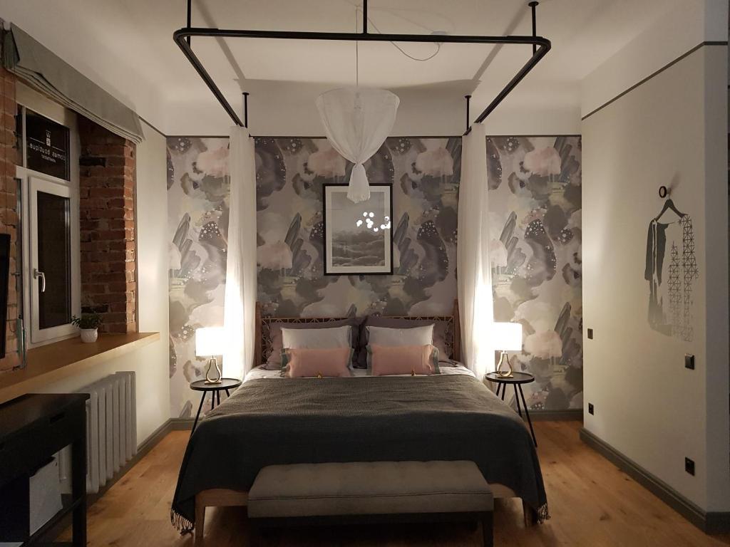 Gulta vai gultas numurā naktsmītnē Domus Boutique apartment