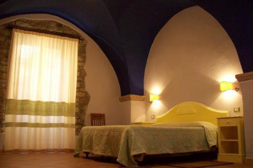 Letto o letti in una camera di Sa Balza Guest House