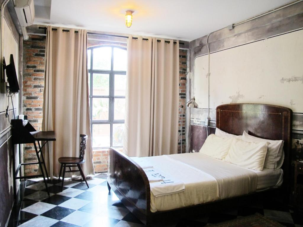 A bed or beds in a room at J No.14
