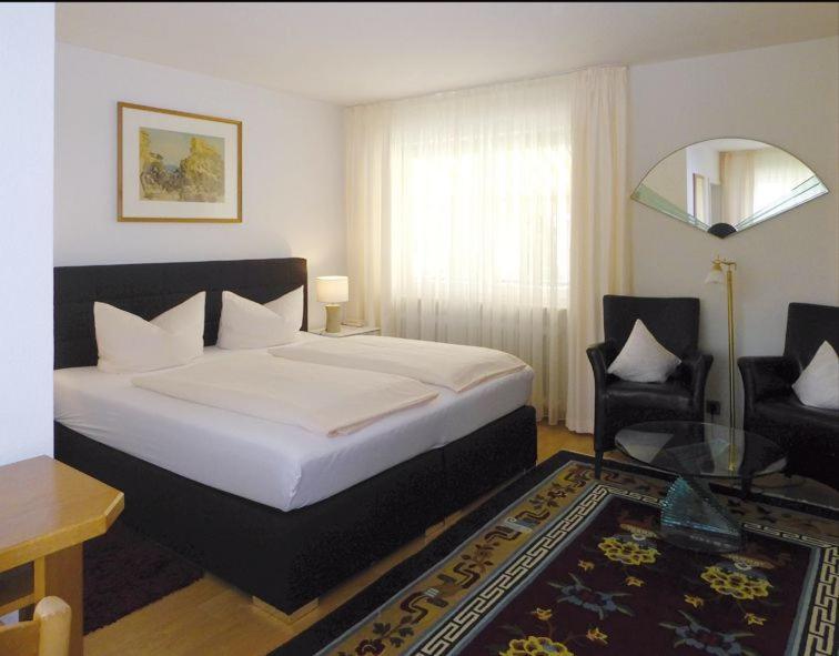 Ein Bett oder Betten in einem Zimmer der Unterkunft Hotel Hofmann Zur Mühle