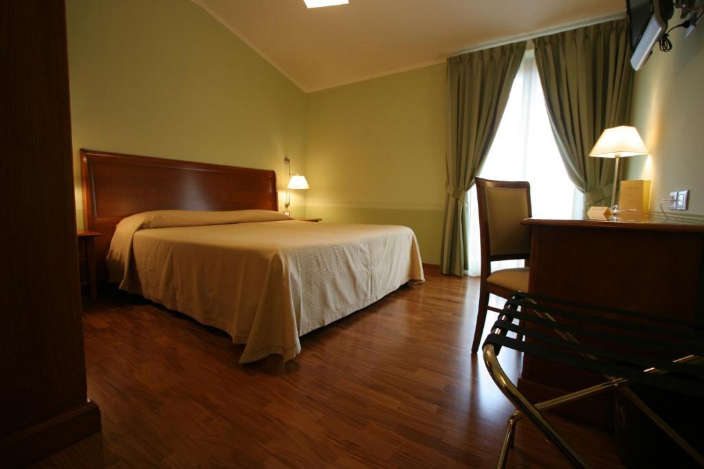 Letto o letti in una camera di HOTEL L' ANFORA