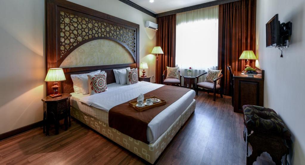 Кровать или кровати в номере Отель Ориент Стар