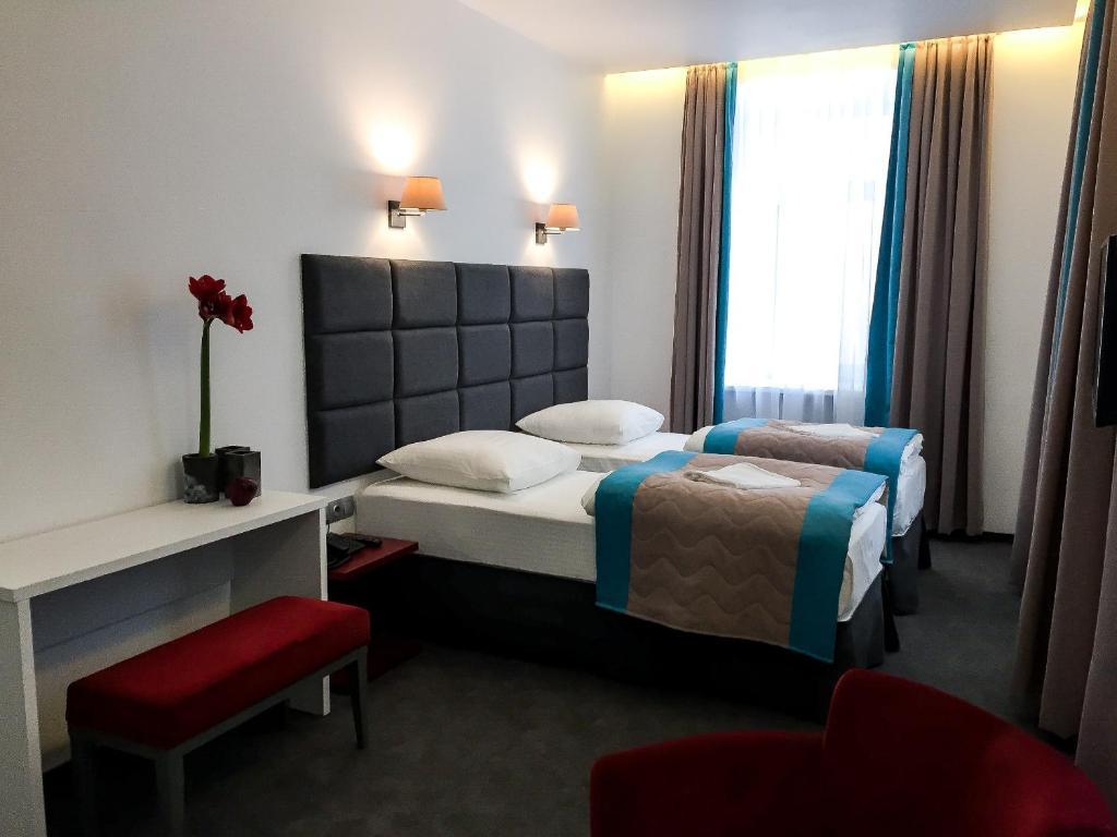 Кровать или кровати в номере Веллион Павелецкая