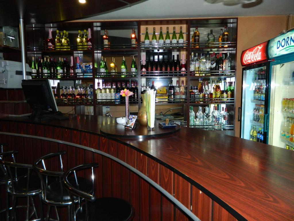 The lounge or bar area at Vila Tom Cris