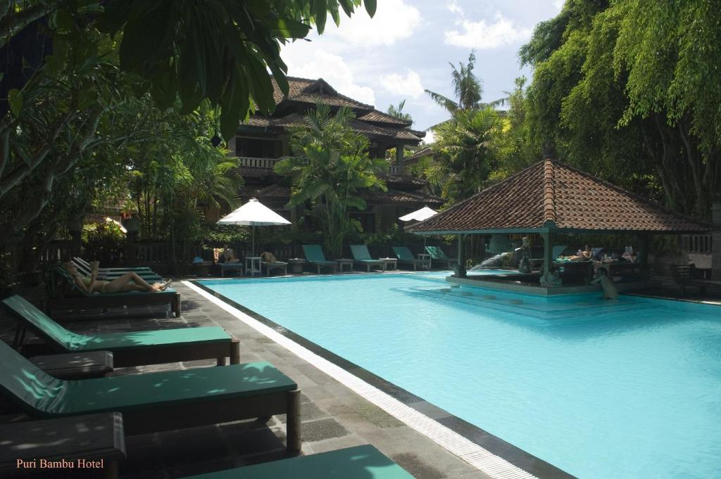 The swimming pool at or near Hotel Puri Bambu