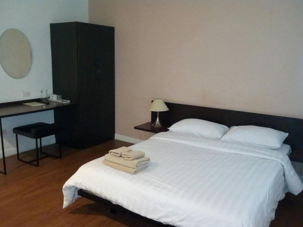 A bed or beds in a room at G9bangkok